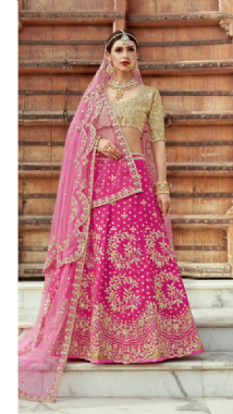 Vibrant Pink Lehenga With A Gold Blouse
